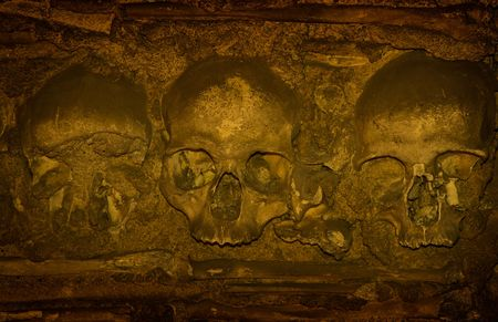 infernal: Human bones and skulls covering inner walls of the Chapel of Bones in Evora, Portugal.