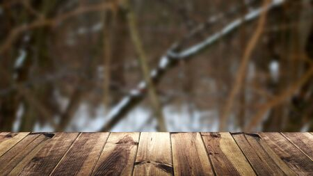 Perspective wood and blur background. Snow composition