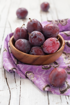 Sweet fresh plum in the wood bawl Stock Photo - 15251372