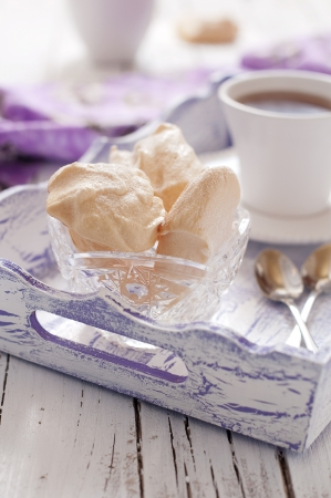 Sweet homemade meringue with tea Stock Photo