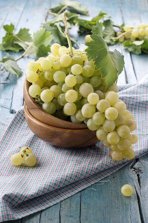 Yellow sweet grapes with green leave Stock Photo - 15313138