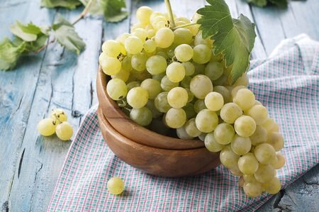 Yellow sweet grapes with green leave