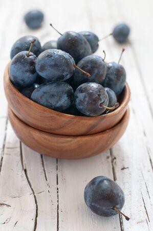 Black sweet plum on the table Stock Photo - 15313095