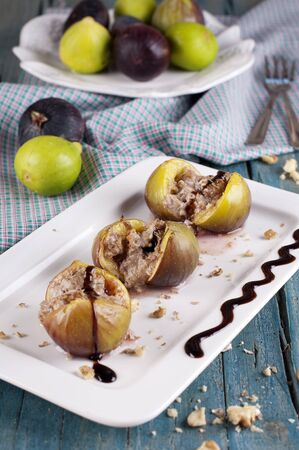 Baked fig with cheese and walnut Stock Photo