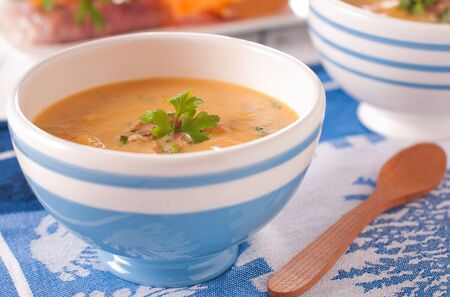 pumpkin soup with ham and parsley Stock Photo