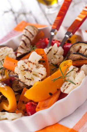 Red and yellow pepper, carrot and aubergine  Stock Photo