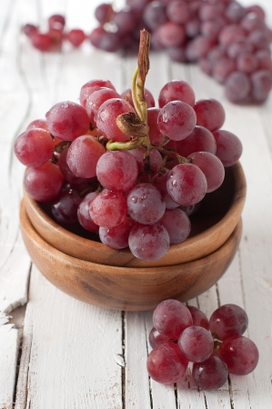Red sweet grapes in the bowl, selective focus
