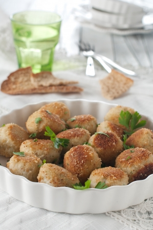 fish cakes with parsley, selective focus Stock Photo