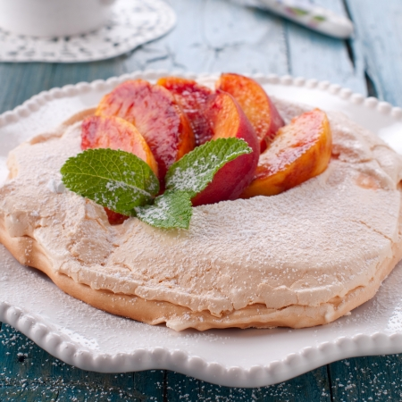 Meringue with mint and peach, square image Stock Photo