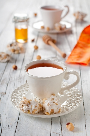 Tea and sweet nougat, selective focus