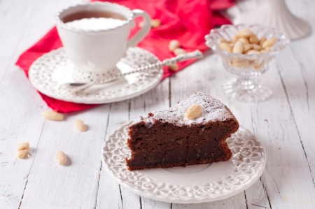Sweet chocolate cake with cup of tea photo