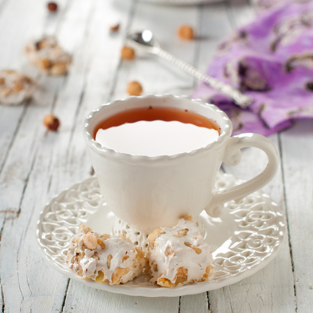 Nougat and cup of tea, square image Stock Photo