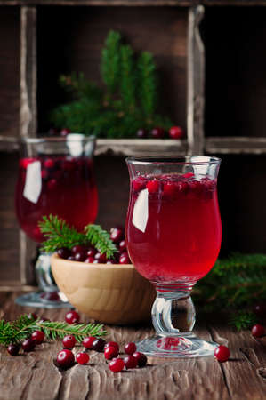 cranberry juice: Fresh red cranberry juice on the vintage table, selective table Stock Photo