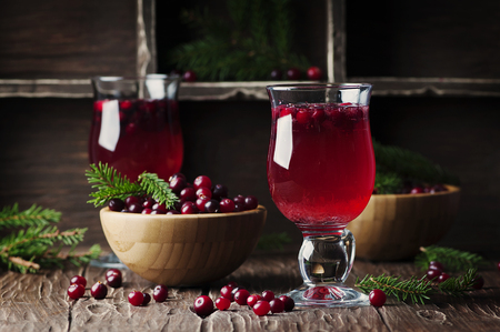 Fresh red cranberry juice on the vintage table, selective table Stock Photo