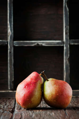 Red sweet pears on the vintage table, selective focus Stock Photo
