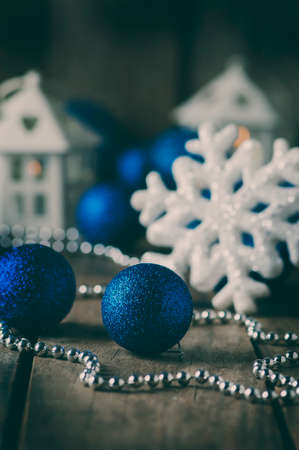Christmas ornament with balls on the wooden table, selective focus and toned image