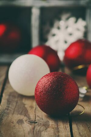 Christmas card with balls on the wooden table, selective focus and toned image