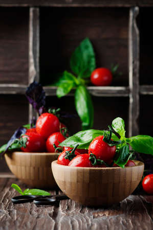 Concept of healthy eating with tomato and basil, selective focus