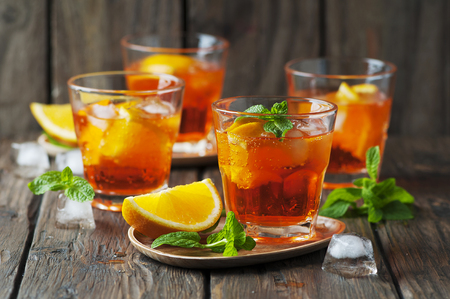 Glass of aperol with ice, orange and mint, selective focus Фото со стока