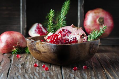 Sweet fresh pomegranate on the vintage table, selective focus