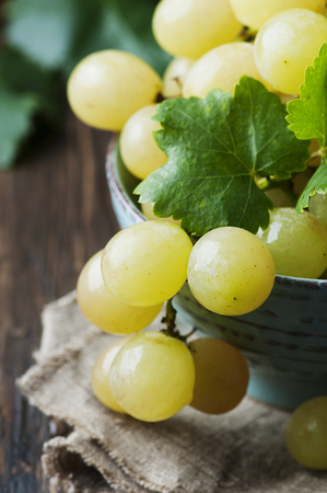 Yellow sweet grape on the wooden table, selective focus Stock Photo