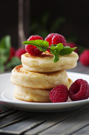 Cottage cheese pancakes, homemade traditional Ukrainian and Russian syrniki, selective focus