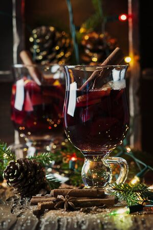 Traditional winter mulled wine and christmas ornament, selective focus Stock Photo