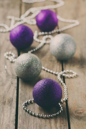 Christmas ornament with balls on the wooden table, selective focus