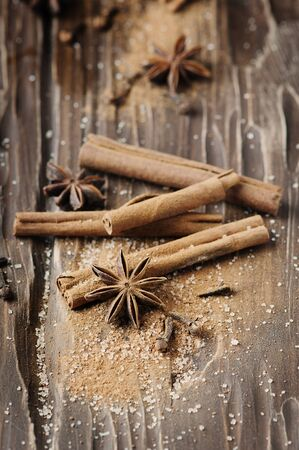 Spices cinnamon and anise on the wooden table, selective focus Stock Photo