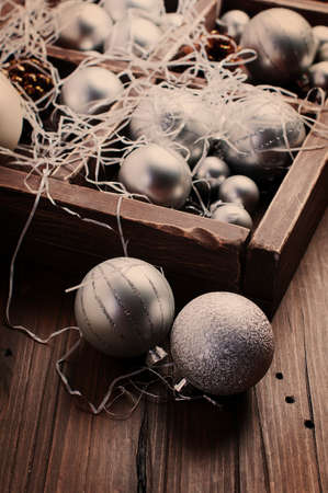 Christmas balls and cones in the wooden vintage box, selective focus