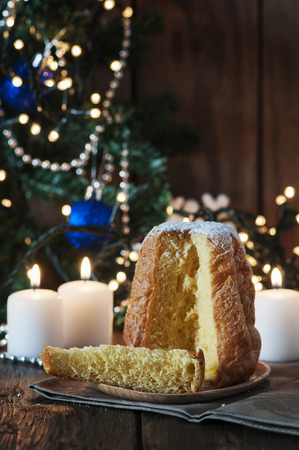 Christmas cake panetone on the wooden table, selective focus Stock Photo
