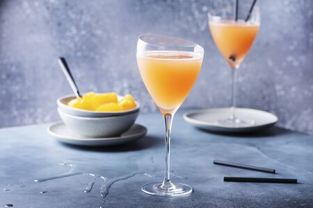 Traditional Italian cocktail bellini with prosecco and peaches, selective focus image