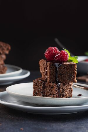 Chocolate cake with caramel, raspberry and mint, selective focus image