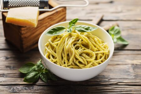 Traditional ligurian spaghetti with basil and cheese, rustic style