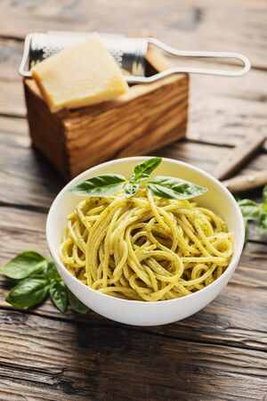 Traditional ligurian spaghetti with basil and cheese, rustic style and selective focus Archivio Fotografico