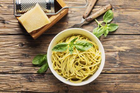 Traditional ligurian spaghetti al pesto with basil and cheese, rustic style and selective focus Archivio Fotografico