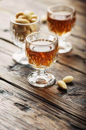 Traditional italian liqueur «Amaretto» with almonds, selective focus Stock Photo