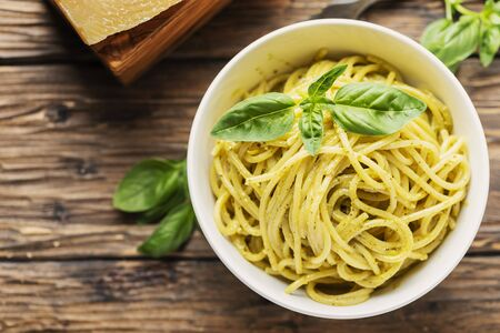 Typical ligurian spaghetti with basil and cheese, rustic style and selective focus Archivio Fotografico