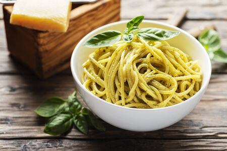 Typical ligurian spaghetti with basil and cheese, rustic style and selective focus