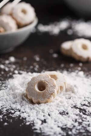 Sweet homemade cookies with powdered sugar, selective focus image