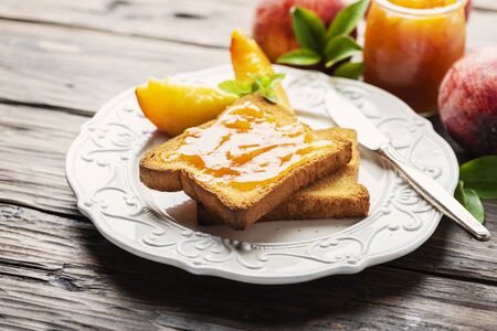 Toast with peach jam for brakfast, selective focus image