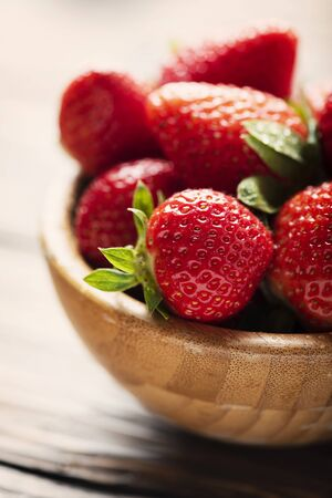Sweet fresh strawberry on the wooden table, selective focus