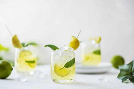 Summer cocktail with sage, lime, peach juice and ice, selective focus 版權商用圖片