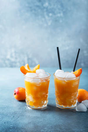 Summer juice with apricots and ice. Bar concept with copy space for your text