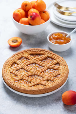 Sweet crust cake with apricots and apricot jam, selective focus image