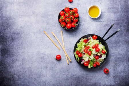 Concept of healthy vegan food. Salad with cucumber, tomato, green salad and chicory