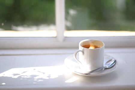 perk: Coffee Cup in Window Sill Stock Photo