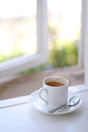 perk: coffee cup in window sill