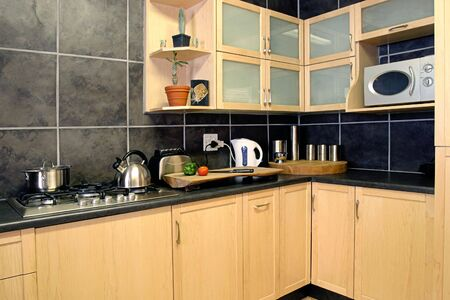 Kitchen witn chopping board in front