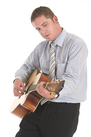 Businessman singing and playing his guitar at work photo